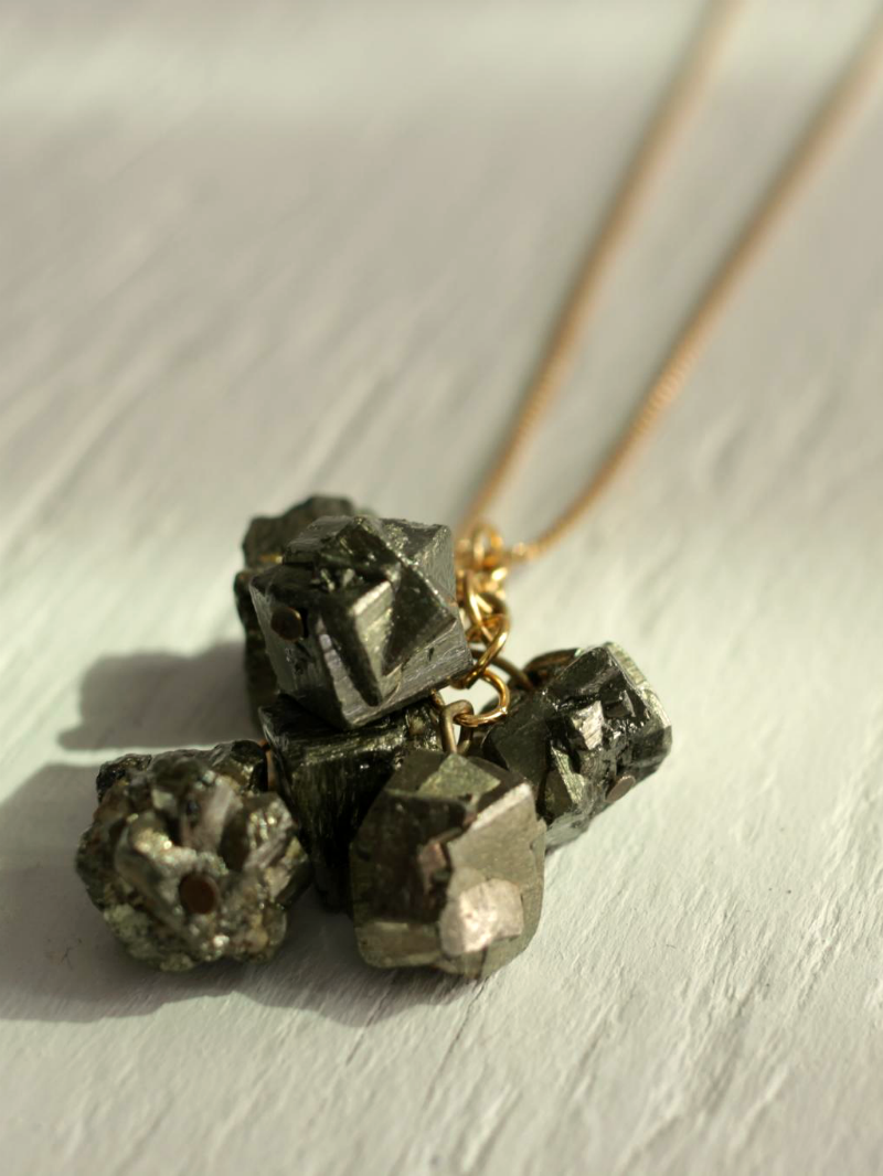 cluster pyrite necklace on gold