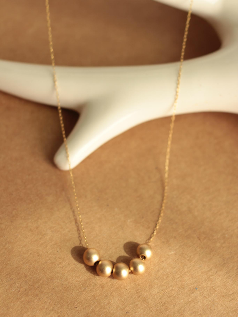 simple gold ball necklace