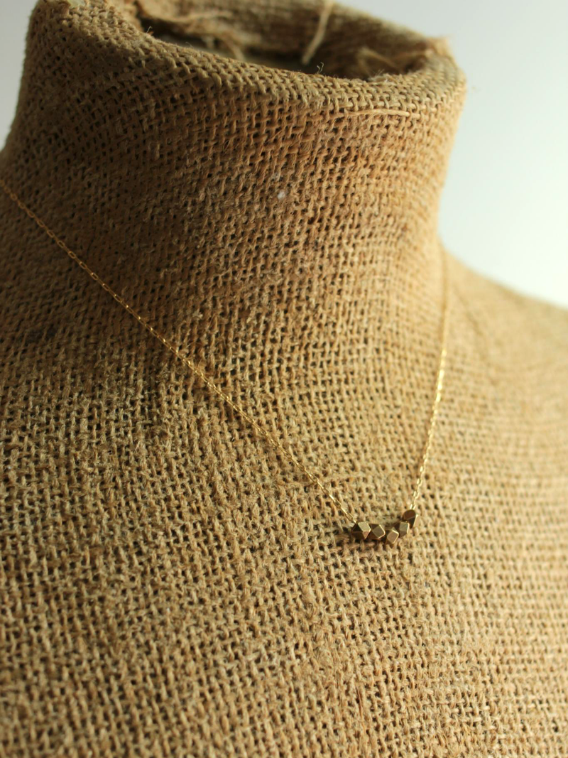 faceted brass cube necklace