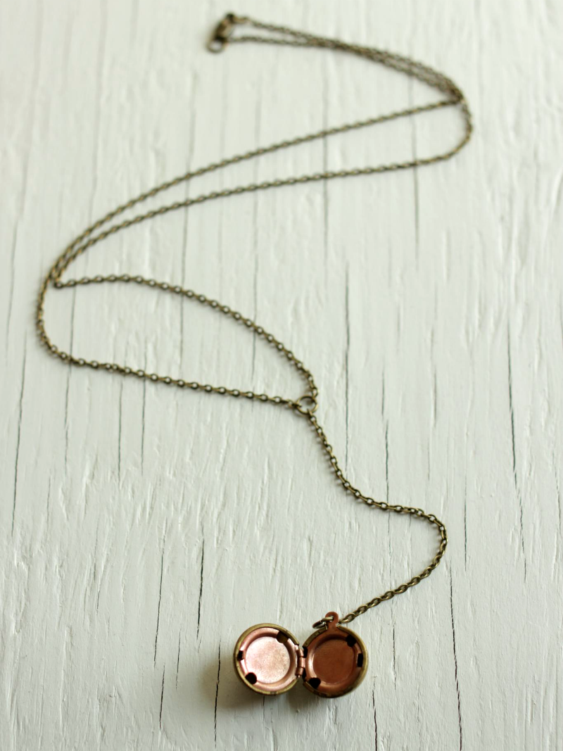 vintage brass ball locket