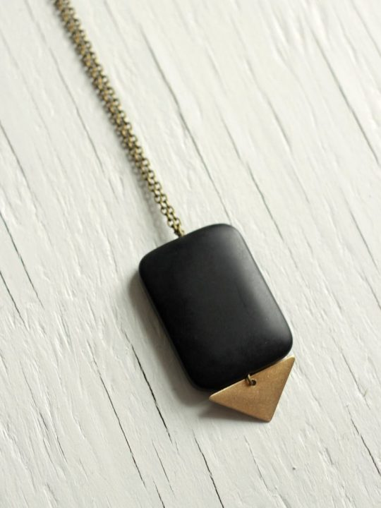 big black stone necklace with triangle