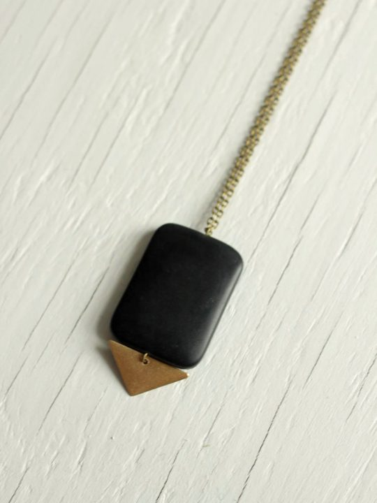 black matte stone necklace with brass triangle