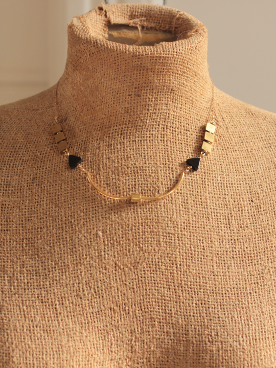 Brass bar necklace measures 16 inches and fits close to your collar