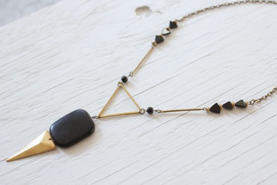 Black geometric necklace made with onyx stones and brass components and chain