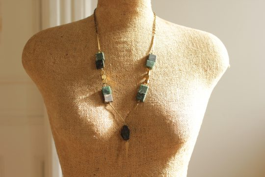 Geometric green marble necklace hangs 26 inches long with a 2.5 inch extender