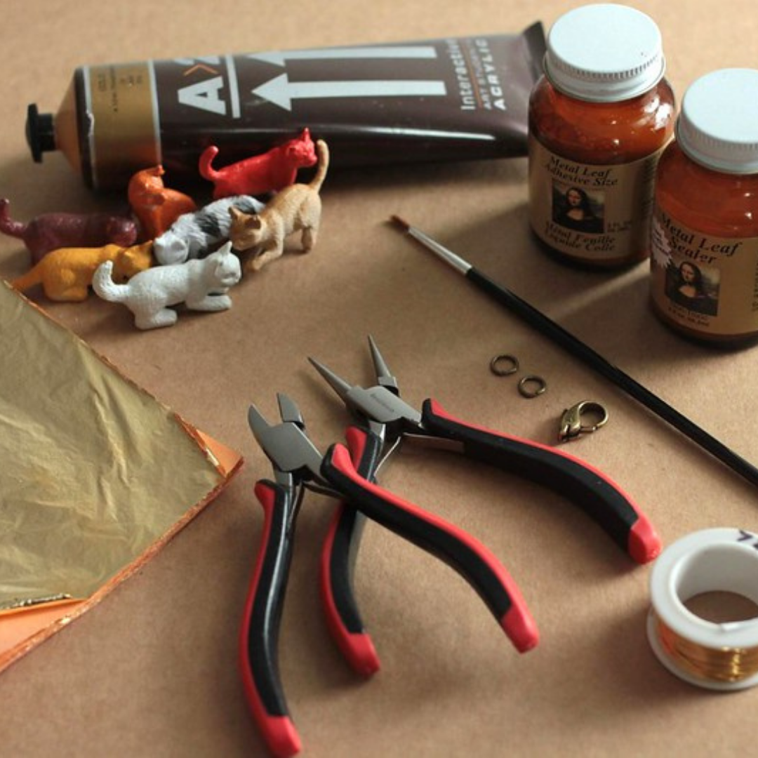 To make this bracelet you'll need plastic cats, gold leaf kit, wire, jewelry findings and wire cutters and pliers