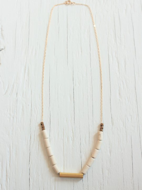 Brass bar necklace with 10 beige magnesite stones