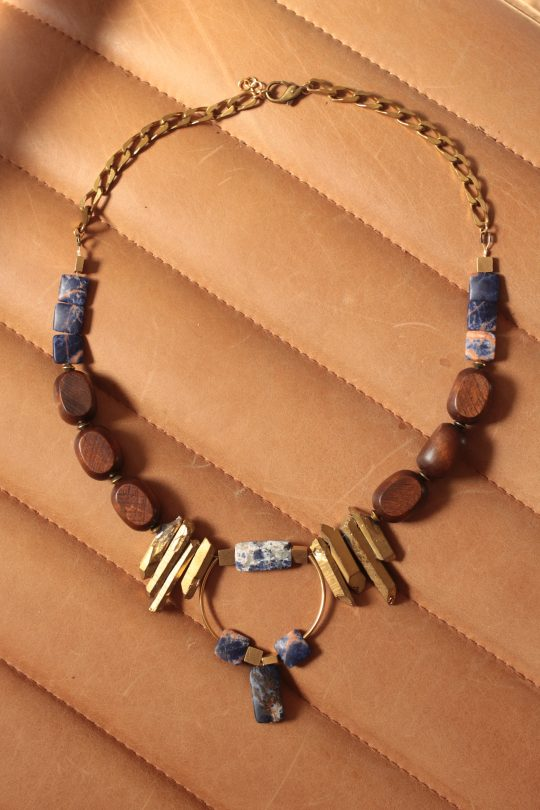Statement necklace features blue, gold and warm brown colors