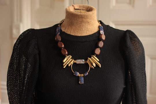 Bold chunky statement necklace can be worn with basics to elevate their style